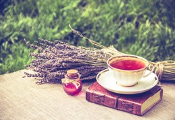 Cup of tea and love potion. Useful tea. Lavender and tea. Tea with lavender extract