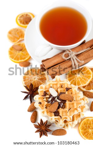 Cup of tea and sweet waffles with walnuts and chocolate for breakfast