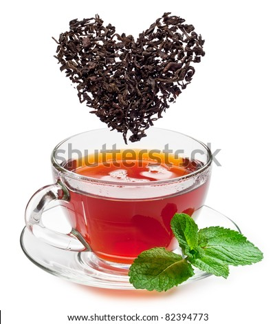 Cup of tea and tea leaves isolated on a white background.
