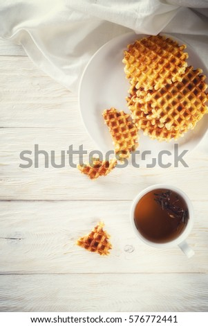 Cup of tea and waffle, top view. Copyspace #576772441