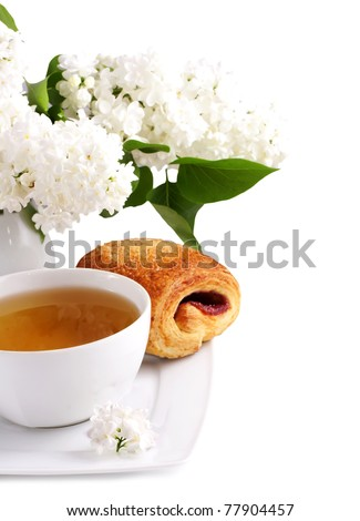cup of tea and white lilac over white