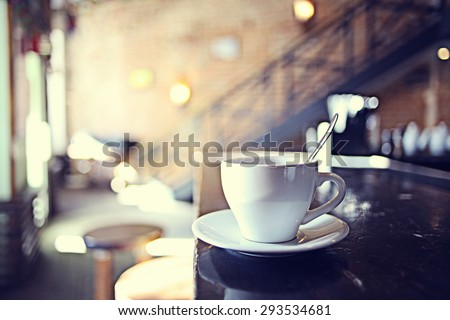 cup of tea at a cafe blurred background