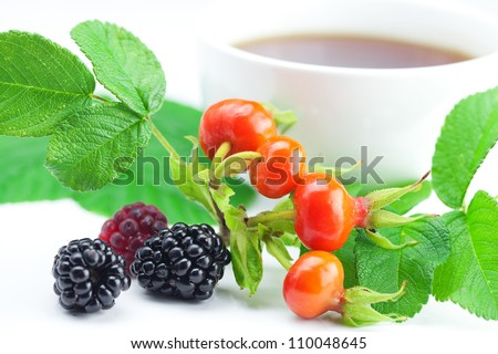 cup of tea, blackberry,raspberry and rosehip berries with leaves