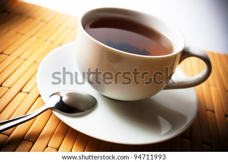 cup of tea in a white cup on a bamboo background.