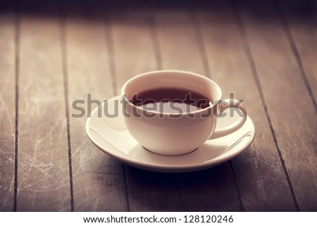 Cup of tea in vintage colour style. - stock photo