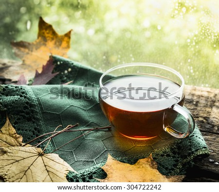 cup of tea on a wooden window...