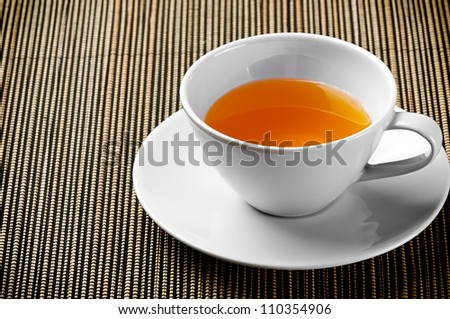 Cup of Tea on Bamboo Table Mat