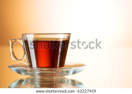 Cup of tea on the reflective surface