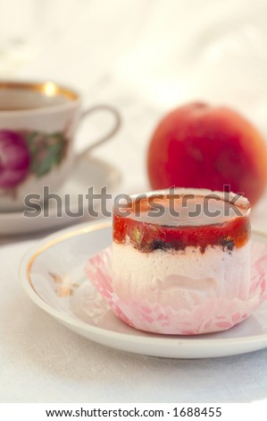 Cup of tea, peach and mousse jelly cake