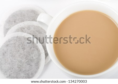Cup of Tea - Simple cup of tea with milk and tea bags on a white background shot from above.