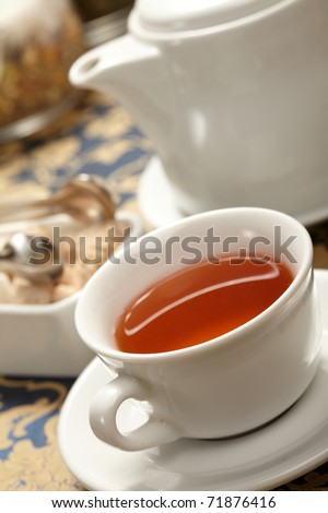 cup of tea with a teapot