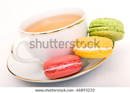 Cup of tea with colorful french macaron