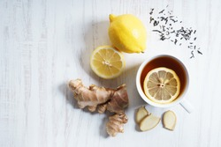 cup of tea with fresh lemon and ginger, top view