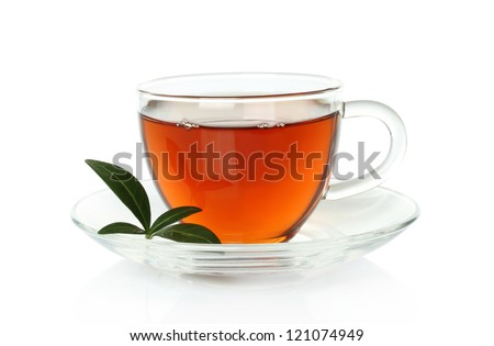 Cup of tea with green leaves on a white background