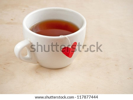 Cup of tea with heart teabag