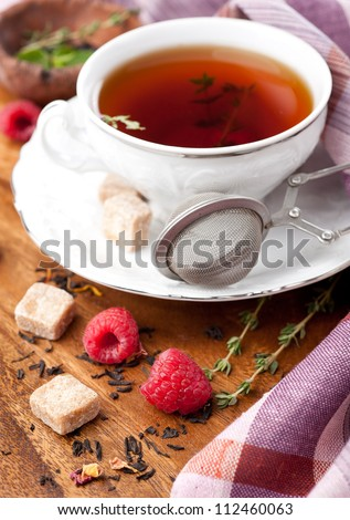 Cup of tea with herbs and berries