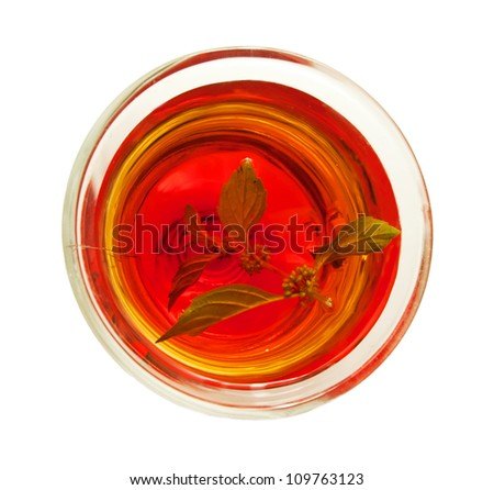 cup of tea with leaves of melissa isolated on white Background. top view