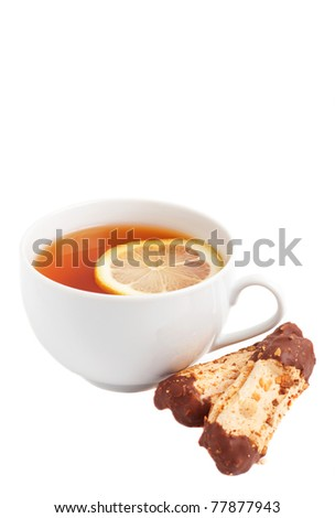 Cup of tea with lemon and chocolate dipped cookies on white background
