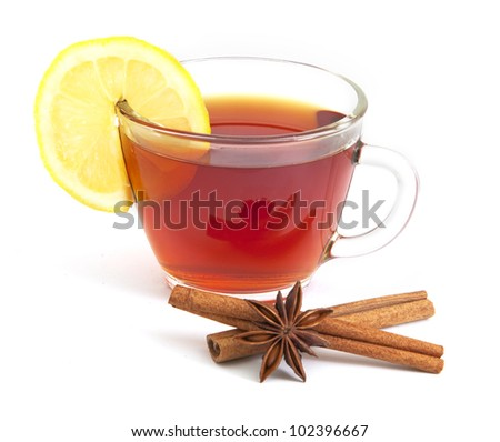 Cup of tea with lemon, anise star and cinnamon on the white background