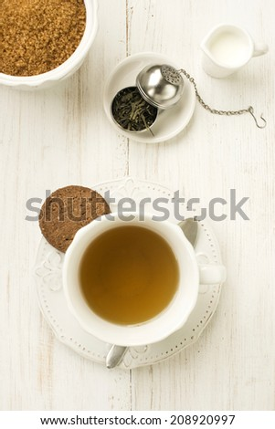 cup of tea with milk, sugar and cookie #208920997