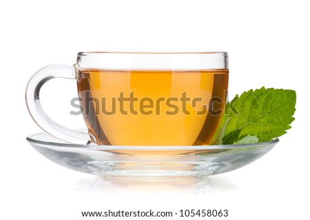 Cup of tea with mint leaves. Isolated on white background