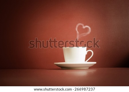 cup of tea with steam in a heart shape and dust on the base, vintage style