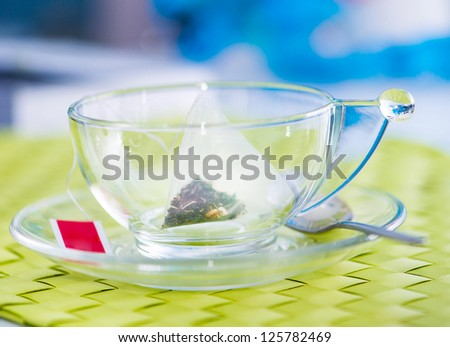 Cup of tea with tea bag. blank label