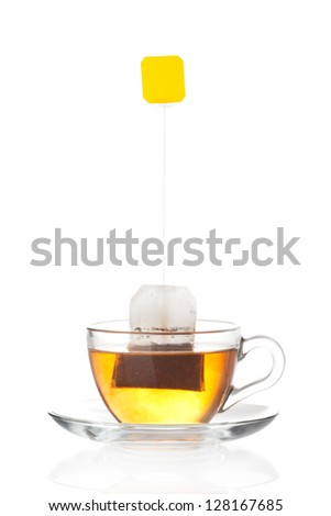 Cup of tea with tea bag (blank label) inside isolated on white background #128167685
