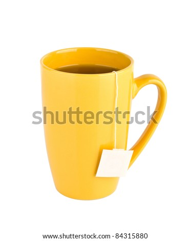 Cup of tea with tea bag (blank label) inside, isolated on white background