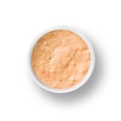 cup of thousand island dressing isolated on a white background