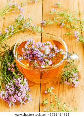 Cup of thyme chaber tea on white wooden background.Shallow dof. Zdjęcia stock ©