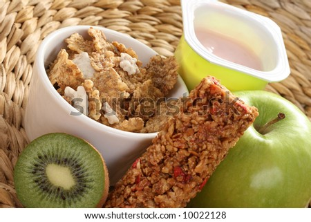 cup of yogurt green apple and cereals