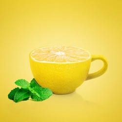 Cup on a yellow background. Cup with a texture of lemon. Creative.