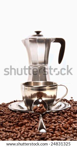 Cup resting on coffee beans with percolator on white