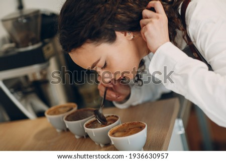 Cup Taster Girl Tasting Degustation Coffee Quality Test. Coffee Cupping Foto stock ©