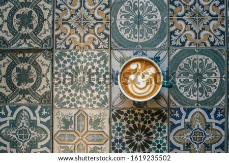 cup with cappuccino on colorful background