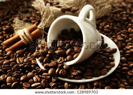 cup with coffee beans  close up