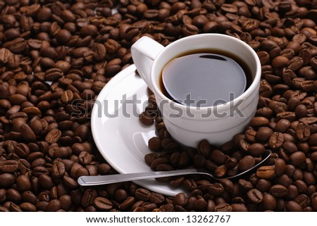 Cup with coffee costing on coffee grain