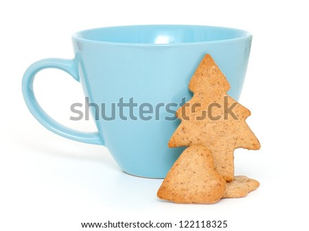 cup with gingerbread cookies isolated on white background