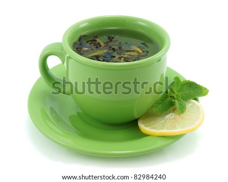 Cup with green tea, with mint and lemon.
