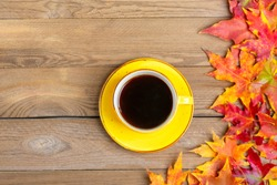 cup with hot black coffee on a wooden table with autumn fallen yellow, orange and red leaves Flat lay Top view Mock up Hello september, october, november, sesonal concept