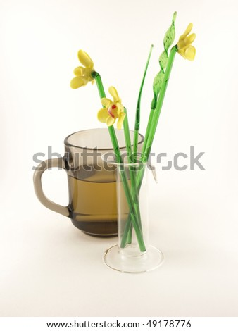 stock-photo-cup-with-juice-and-glass-flowers-49178776.jpg