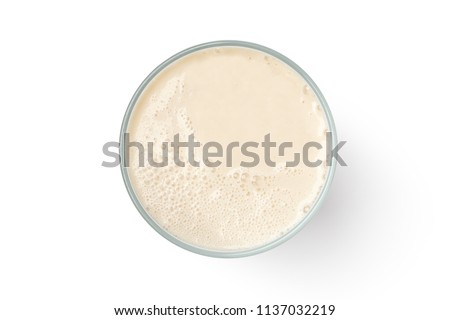 Cup with soy milk bubble foam isolated on white background, top view
