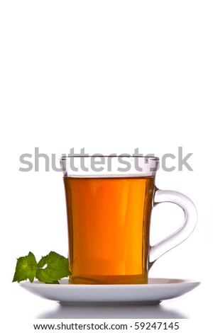 cup with tea and mint on a white background.