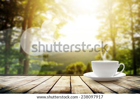 Cup with tea on table over mountains landscape with sunlight. Beauty nature background #238097917