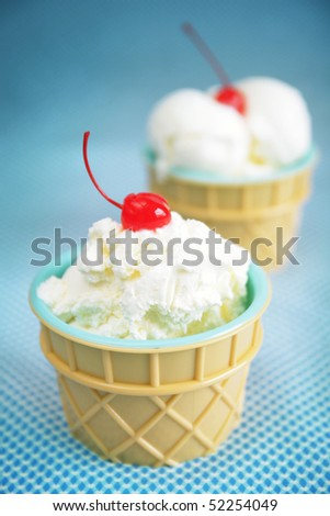 Cup with vanilla icecream on a turquoise background