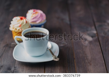 Stock Photo Cupcake and coffee on dark rustic table