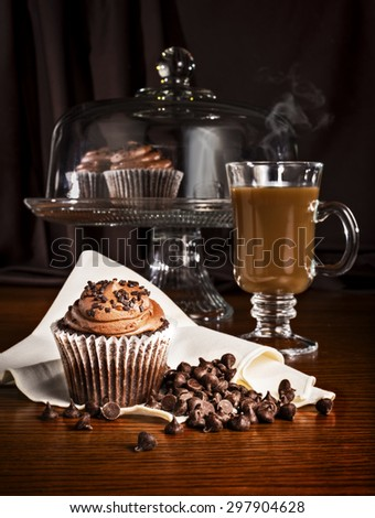 Stock Photo Cupcake and steaming coffee