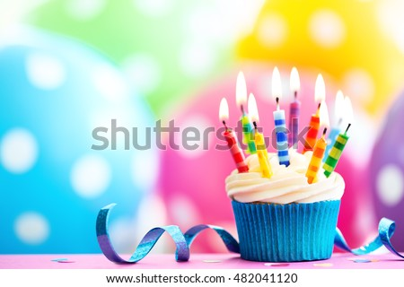 Cupcake decorated with colorful birthday candles #482041120