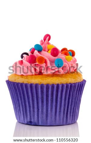 Cupcake for child party with colorful candy